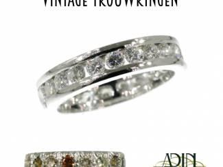 Vintage trouwring met diamant en robijn
