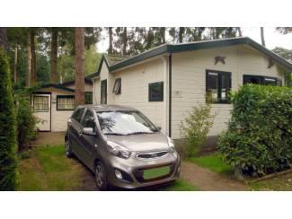 Vakantiehuizen | Benelux Te koop vakantiehuisje midden op de Veluwe met eigen grond