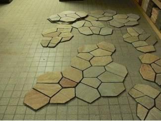Aanbieding granieten tegels aan matje