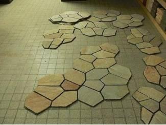 Granieten tegels aan matje